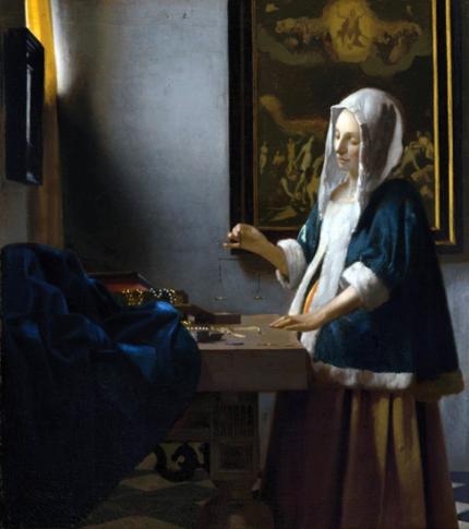 Woman Holding a Balance 1664