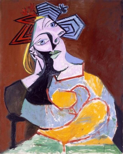 Seated Woman Resting on Elbows