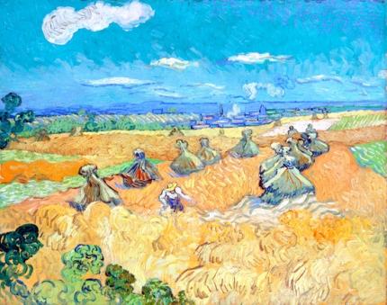 麦束の山と刈る人