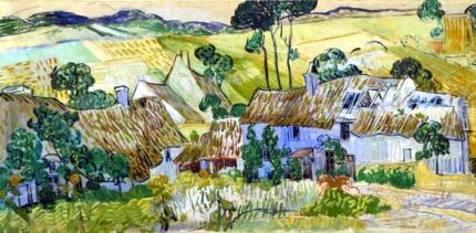 丘沿いのわらぶき屋根の家々
