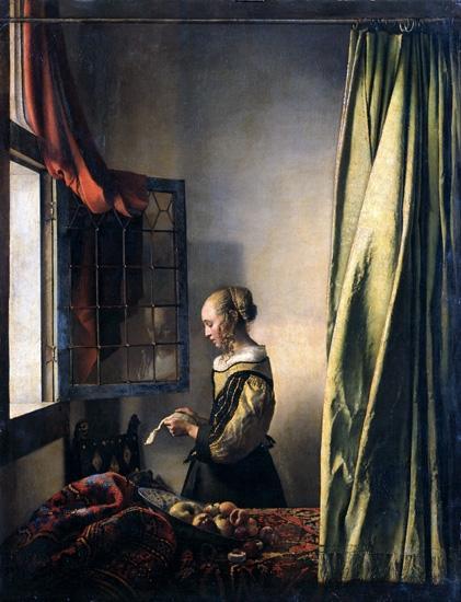 窓辺で手紙を読む女 by ヨハン·フェルメール